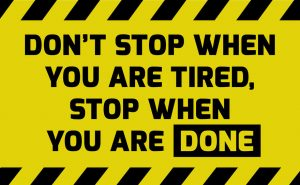 Don't stop when you are tired sign yellow with stripes, road sign variation. Bright vivid sign with warning message.